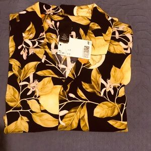 H&M shirt ..The shirt is navy blue with lemons